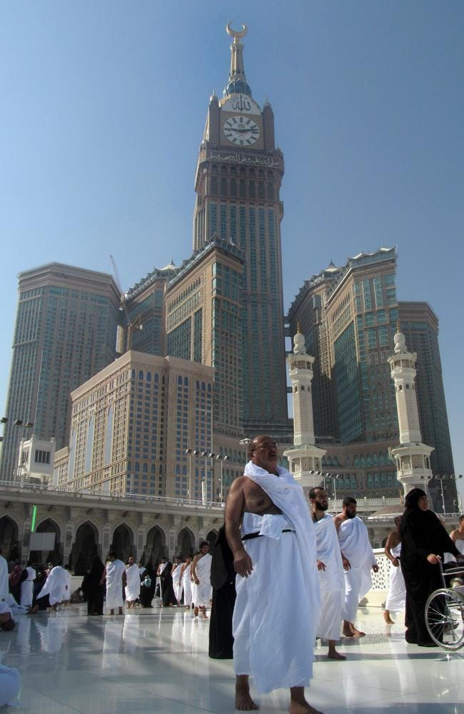 The tallest clock tower in the world with the world's largest clock face, atop the Abraj Al-Bait Towers, overshadows Muslim pilgrims as they gather in Mecca. Picture: AP/Amr Nabil
