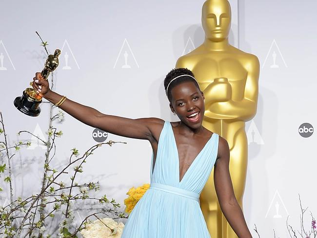 Her man ... Lupita Nyong'o celebrating with her Oscar after winning the Best Performance