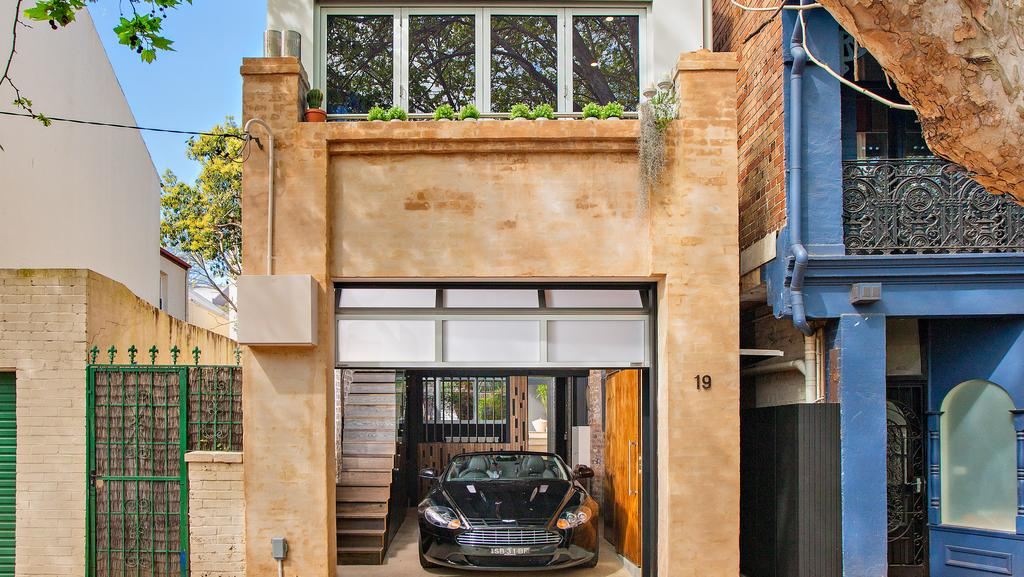 Real estate conversions stunning properties the courier mail for Garage saint just