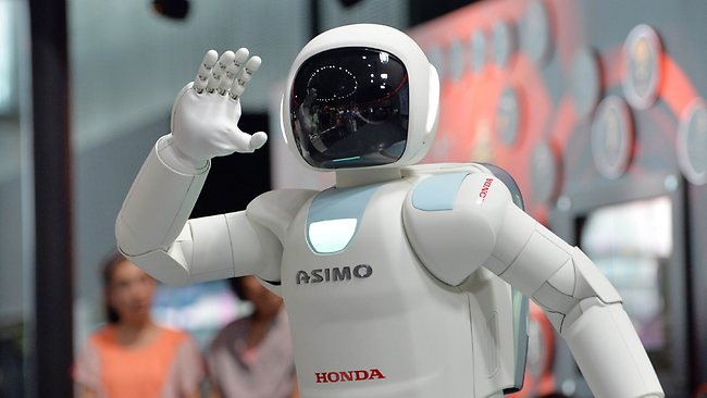 Honda humanoid robot Asimo interacts with visitors at the National Museum of Emerging Science and Innovation in Tokyo.