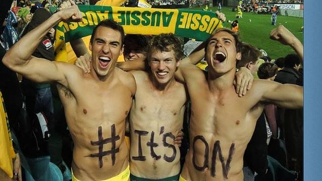 Three socceroos fans in budgie smugglers watching the game vs Iraq.