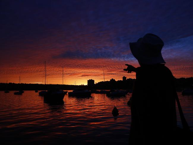 Cleveland Rose watches the fiery sunset over Manly Cove / Picture: Brad Hunter