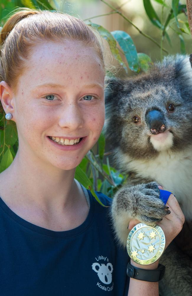 Libby Fisher, 12, meets Merri the two-year-old koala at Healesville Sanctuary. Picture: Jay Town