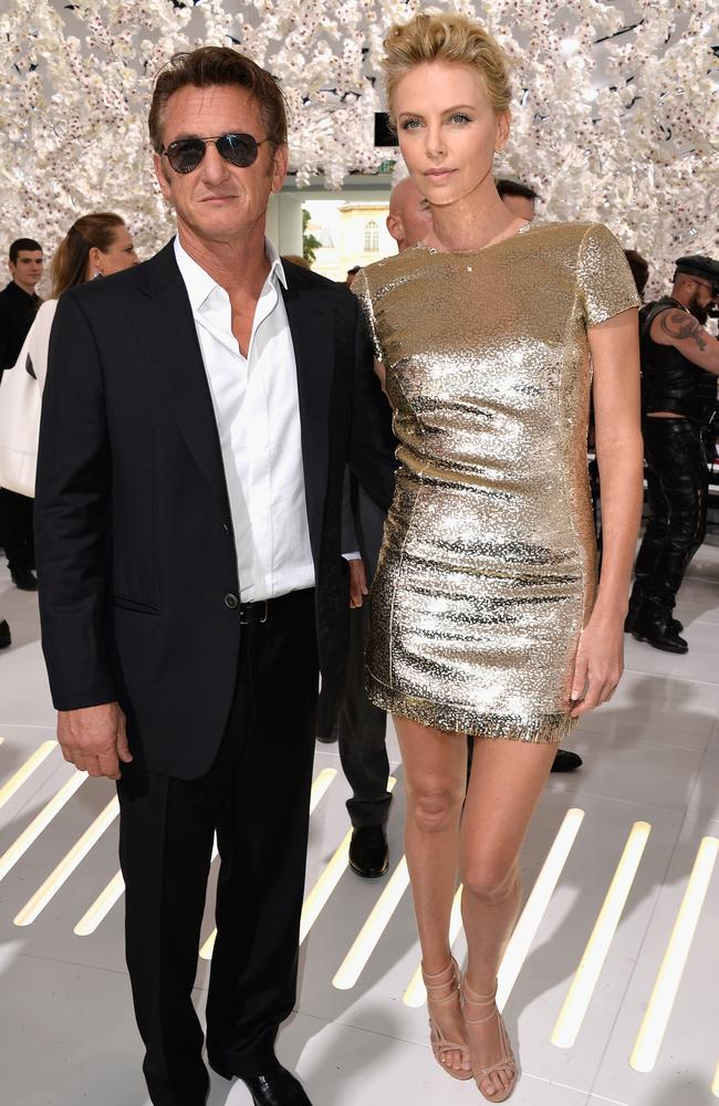 "Golden girl ... Sean Penn and Charlize Theron, wearing a shimmering fringed cocktail dress similar to the one she appears in for Dior's now-iconic ""J'Adore"" perfume advert."