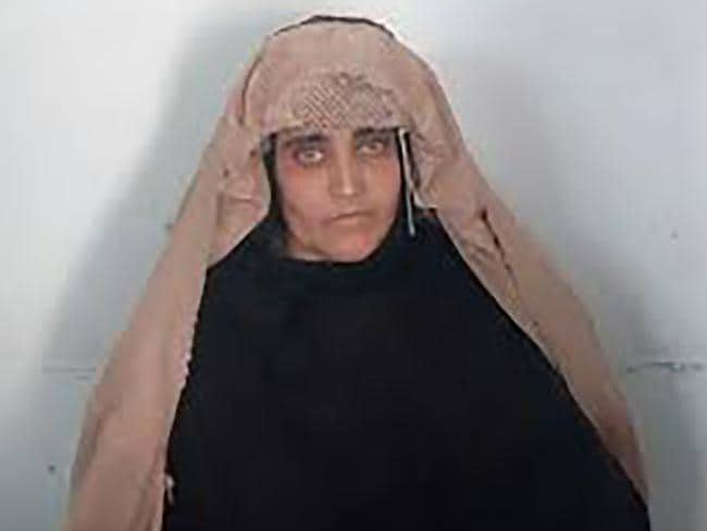 Sharbat Gula, a 'Afghan Girl', awaits her justice conference in Peshawar. Picture: AFP/FIA