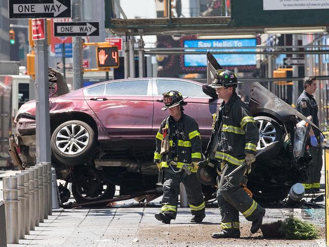 A wrecked car sits in the intersection of 45th and Broadway in Times Square, New York. Picture: Drew Angerer/Getty Images/AFP