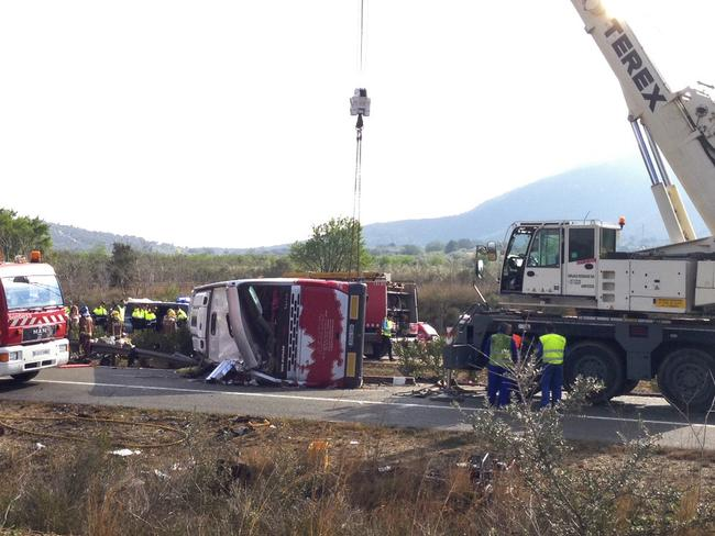 Shocking scene ... emergency crews rushed to the scene after a bus crashed on the AP7 highway linking Spain and France. Picture: AP Photo