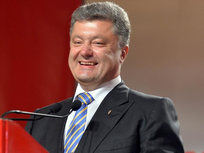 Success: Petro Poroshenko claims victory in Ukraine presidential election. AFP PHOTO / SERGEI SUPINSKY