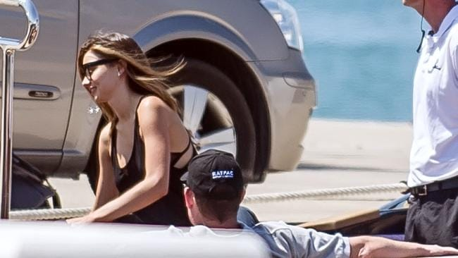 Romantic getaway ... Miranda Kerr is all smiles as she greets rumoured boyfriend James Packer on board a boat, which took the pair to his waiting luxury super yacht. Picture: Splash News