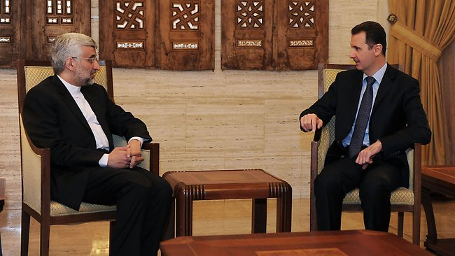 "A handout picture released by the official Syrian Arab News Agency (SANA) on February 3, 2013, shows Syrian president Bashar al-Assad talking with Saeed Jalili, who heads the Iranian Supreme National Security Council in Damascus. ""We will give all our support so that Syria remains firm and able to face all the arrogant (Western) conspiracies,"" said Saeed Jalili. AFP PHOTO / HO-SANA --- RESTRICTED TO EDITORIAL USE - MANDATORY CREDIT ""AFP PHOTO/HO/SANA"" - NO MARKETING - NO ADVERTISING CAMPAIGNS - DISTRIBUTED AS A SERVICE TO CLIENTS"