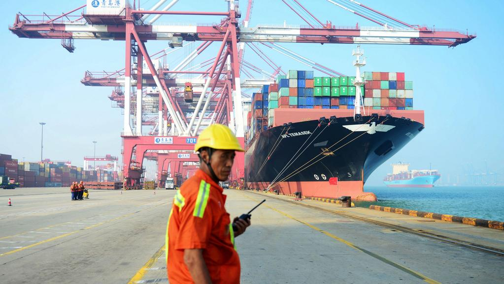 A cargo ship is loaded at a port in Qingdao. The State Government has moved its SinoSA office from the eastern Shandong city. Picture: AFP.