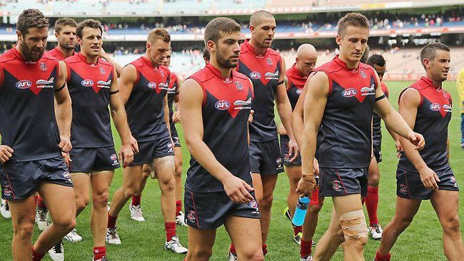 The Demons leave the field after their Round 1 defeat.
