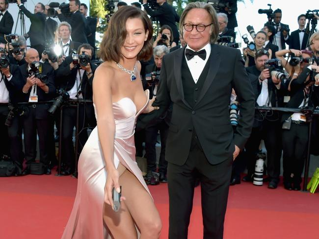 Bella Hadid on the red carpet with her dad. Picture: Pascal Le Segretain/Getty Images