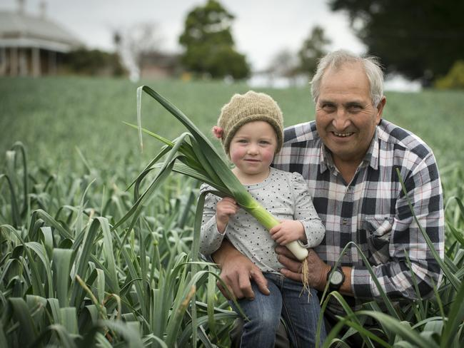 UNIQUE: Farmer Ken Cobbledick — pictured with his granddaughter Ella — is backing efforts for World Heritage listing for farm lands in the area. Picture: Matt Turner.