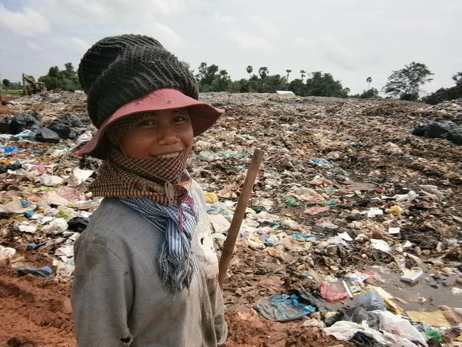 A child poses for a photograph at the rubbish dump in Anlung Pey which is home to 300 people. Pic: APP.