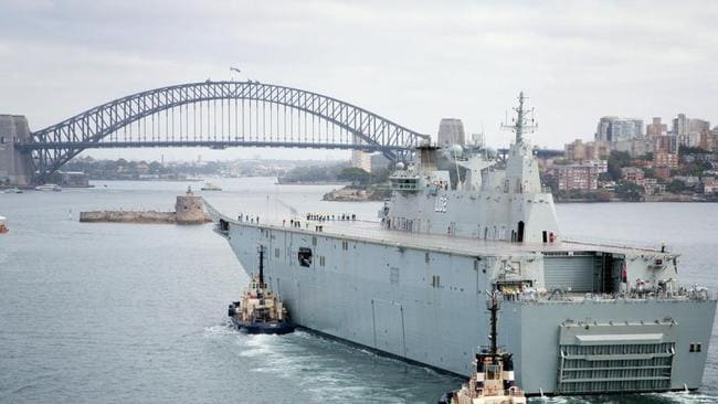 The largest ship ... ever built for the Royal Australian Navy, Landing Helicopter Dock Canberra, entered Sydney Harbour for the first time during the contractor sea trials and testing program.