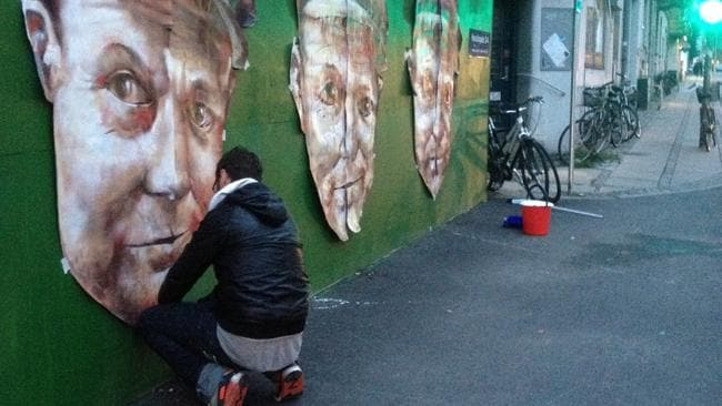 Magee works on the Adam Cullen artwork. Picture: Fintan Magee