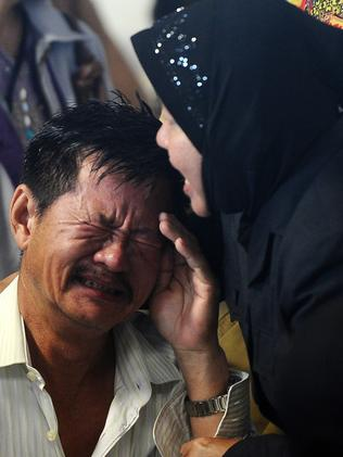 Relatives of passengers break down at the news of debris and bodies being found. Picture: Robertus Pudyanto