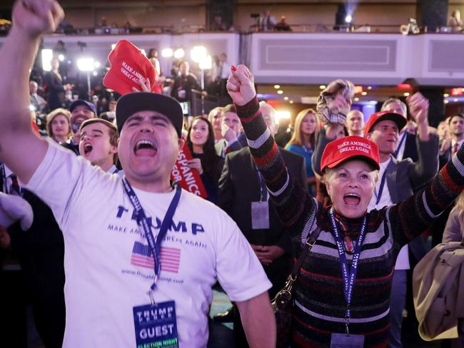 Supporters of Republican presidential nominee Donald Trump cheer during the election night event at the New York Hilton Midtown in New York City. Picture: Chip Somodevilla/Getty Images/AFP