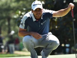 (FILES) This file photo taken on April 9, 2016 shows Australia's Jason Day as he lines up a putt on the 1st green during Round 3 of the 80th Masters Golf Tournament at the Augusta National Golf Club in Augusta, Georgia. World number one Jason Day said June 23, 2016 he remains undecided about whether or not he will compete at the Rio Olympics because of worries about the mosquito-transmitted Zika virus. Speaking at a promotional event ahead of defending his first major title at next month's PGA Championship at Baltusrol, the 28-year-old Australian said he will talk with his family and agent Bud Martin about the risks before taking a final decision. / AFP PHOTO / Nicholas Kamm