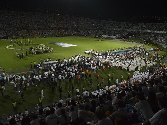 Fans of Colombia's Atletico Nacional hold a tribute.