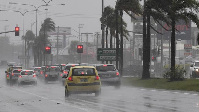 Drivers endure heavy rain and strong winds on Queensland's Sunshine Coast on Monday. Picture: AAP Image/Dan Peled