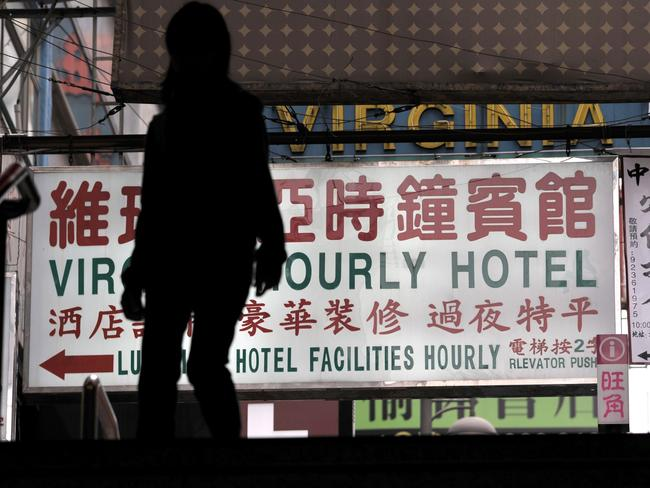 "A sign for an ""hourly hotel"" allegedly used for sexual encounters in a popular shopping district in Hong Kong. Picture: Antony Dickson"