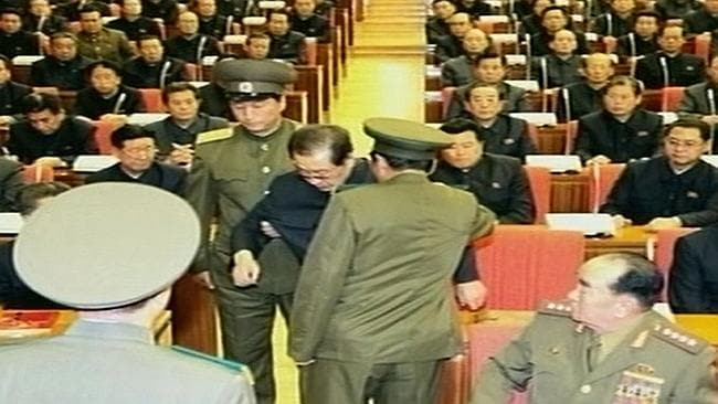 Footage shows Jang Song-Thaek being dragged from his chair by two police officials during a meeting in Pyongyang. Picture: AFP