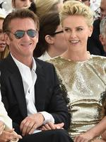 Hollywood icons Sean Penn and Charlize Theron have barely left each other's side since becoming an item. They've been spotted getting coffee, supermarket shopping and, as seen here, attending the Christian Dior show as part of Paris Fashion Week. Picture: Getty