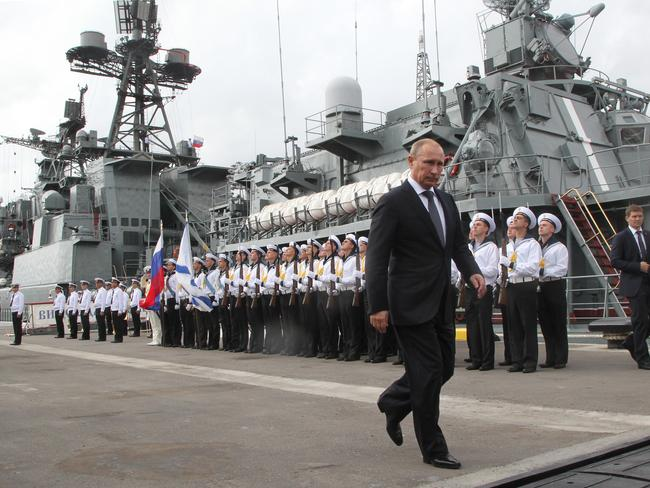 Tensions ... Russian President Vladimir Putin visits a destroyer at the Naval Base of Black Sea Fleet. Picture: Getty