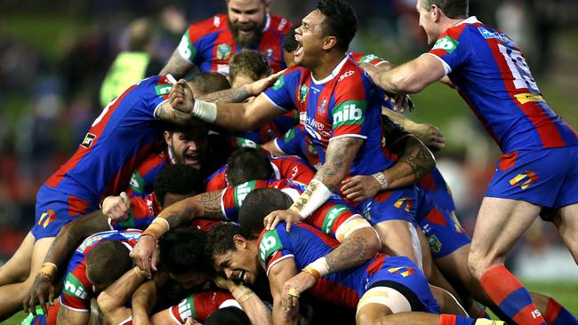 Knights players celebrate the win over the Storm.