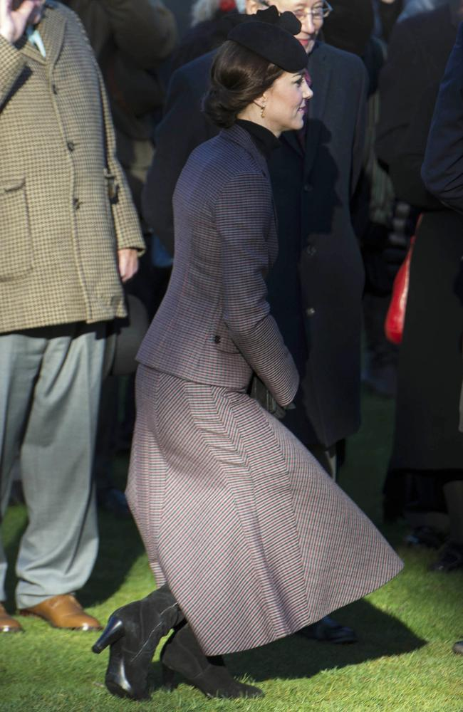 The Duchess of Cambridge curtsies to the Queen at Sandringham Estate in Norfolk. Picture: Andrew Parsons/i-Images/Picture Media