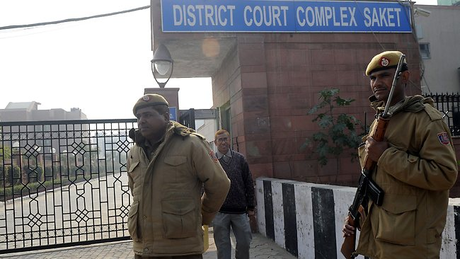Indian police personnel stand guard outside the district court Saket in New Delhi on January 5, 2013. Claims of police incompetence and public apathy stirred new anger in the Delhi gang-rape case after the boyfriend of the victim recounted details of the savage attack for the first time. The man was the only witness to the gang-rape of his girlfriend by six men on a moving bus on December 16 which has stirred sometimes violent protests against the treatment of women in Indian society and an apparent rise in sex crime. AFP PHOTO/ Prakash SINGH