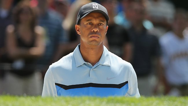 Tiger Woods reacts to a bunker shot on the fourth hole during the first round of the 95th PGA Championship.