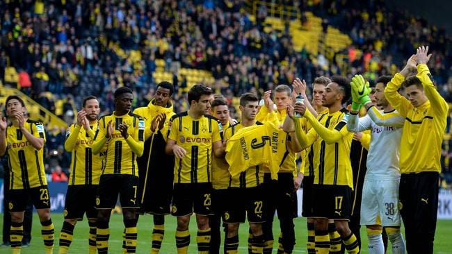 Dortmund players celebrate the win with fans.