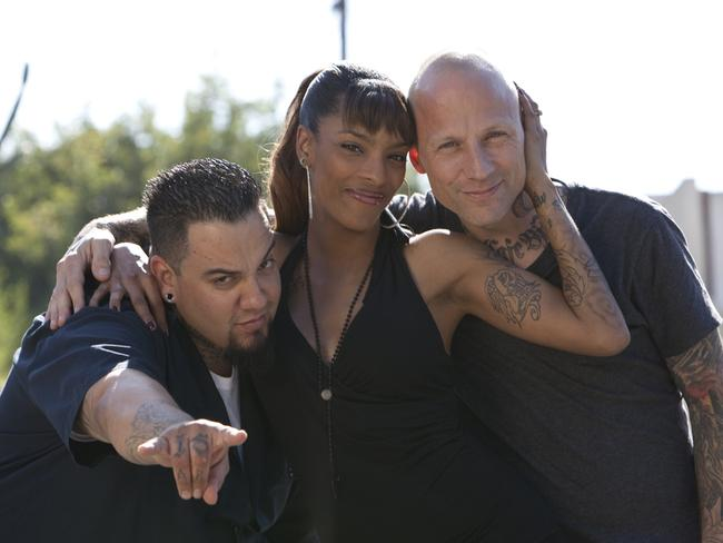 "Cover up artist ... ""There's been some crazy tattoos,"" says Helm, right, with Jasmine Rodriguez and Big Gus. Picture: Supplied"
