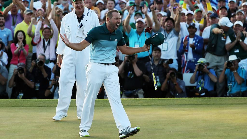 AUGUSTA, GA — APRIL 09: Sergio Garcia of Spain and caddie Glen Murray celebrate after defeating Justin Rose (not pictured) of England on the first playoff hole during the final round of the 2017 Masters Tournament at Augusta National Golf Club on April 9, 2017 in Augusta, Georgia. (Photo by David Cannon/Getty Images)