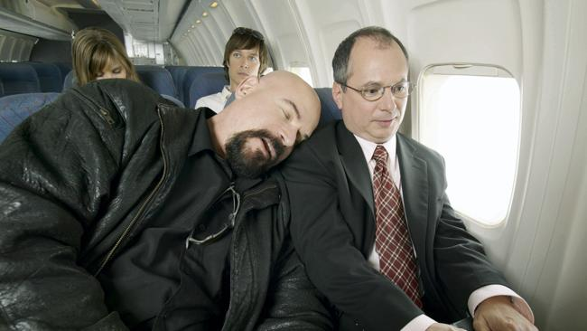 Avoid sleeping with your head on your seatmate's shoulder. Picture: Thinkstock