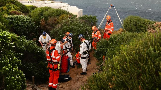 Police rescue and emergency services officers at Little Marley Beach.