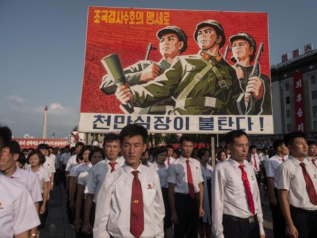 A propaganda poster is displayed during a rally in support of North Korea's stance against the US, on Kim Il-Sung square in Pyongyang on August 9. Picture: AFP