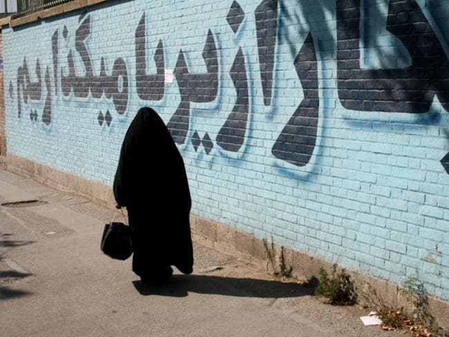 An Iranian woman goes about her business.