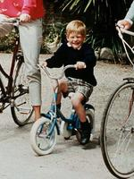 <p>Prince Harry, chuffed to be on his bike, in the 80s.Picture: Supplied</p>
