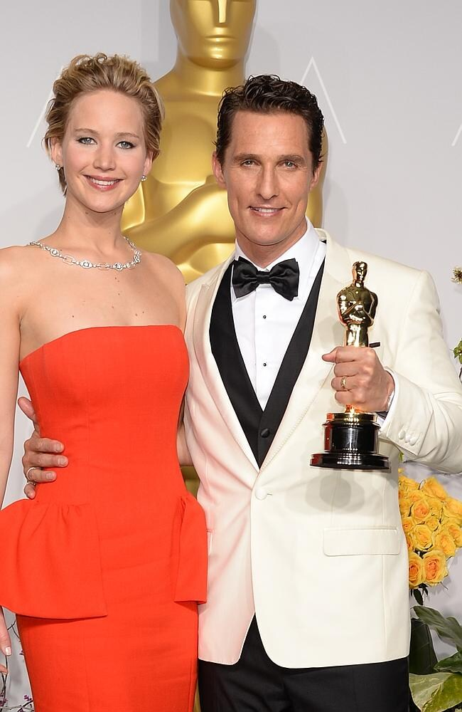 Actors Jennifer Lawrence (L) and Matthew McConaughey, winner of Best Performance by an Actor in a Leading Role pose in the press room during the Oscars at Loews Hollywood Hotel on March 2, 2014 in Hollywood, California. (Photo by Jason Merritt/Getty Images)