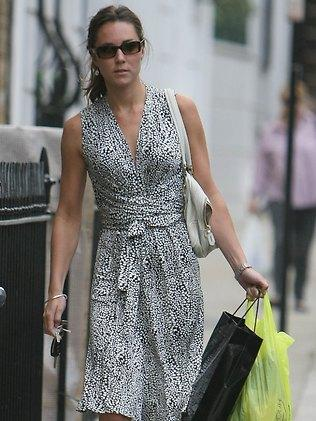 Kate has often been snapped indulging in some retail therapy. She looks less than thrilled to be photograhed in this 2007 picture. Picture: Snapper Media