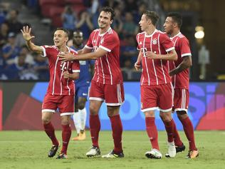 Rafinha of Bayern Munich, left, celebrates scoring the opening goal against Chelsea as the soccer clubs met during the International Champions Cup 2017 soccer match, Tuesday, July 25, 2017 in Singapore. (AP Photo/Joseph Nair)