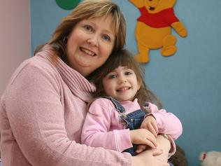 NEWS: NEWS: Pride of Australia Medal 2007, Tasmania nominee for Community Spirit, Jenny Piemontese of Sandford with three-year-old daughter Brianna in one of her foster children's bedrooms