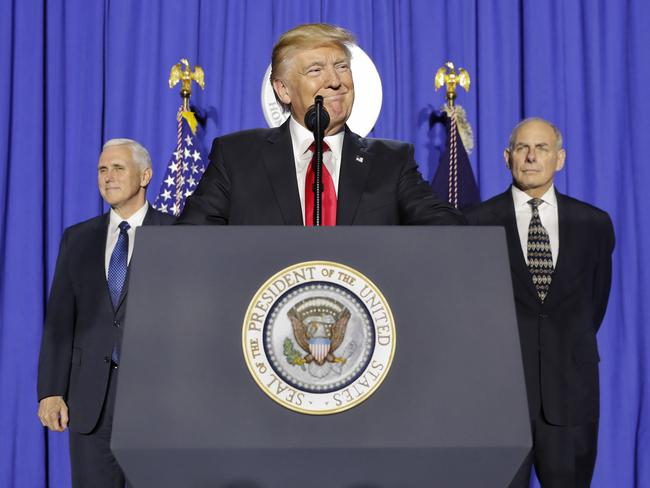 President Donald Trump (centre) flanked by Vice President Mike Pence (left) and Homeland Security Secretary John F. Kelly. Picture: AP Photo/Pablo Martinez Monsivais