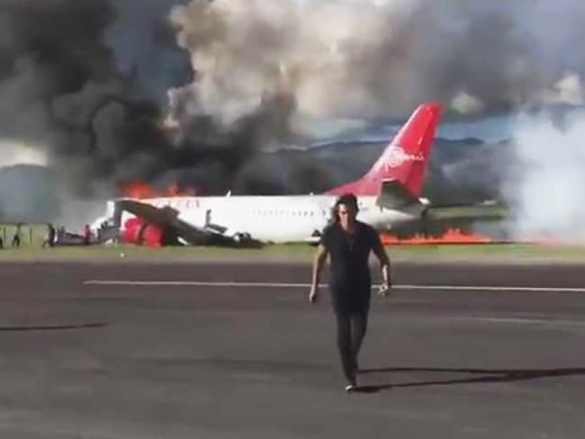 Plane bursts into flames after landing on runway in Peru. Picture: Twitter