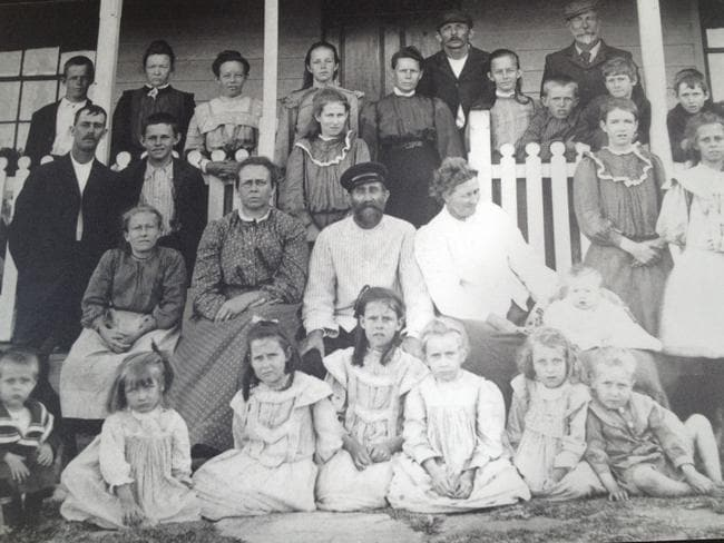 Edith Anderson is shown standing behind lightkeeper Fred Anderson, the man in the middle with the hat.