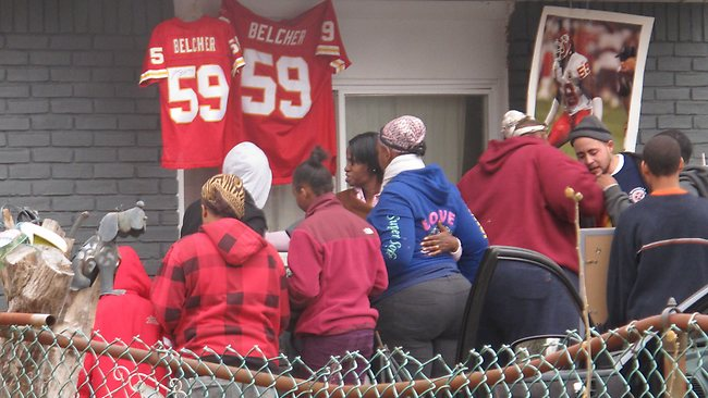 Friends and relatives of Kansas City Chiefs linebacker Jovan Belcher grieve outside the player's home. Picture: AP